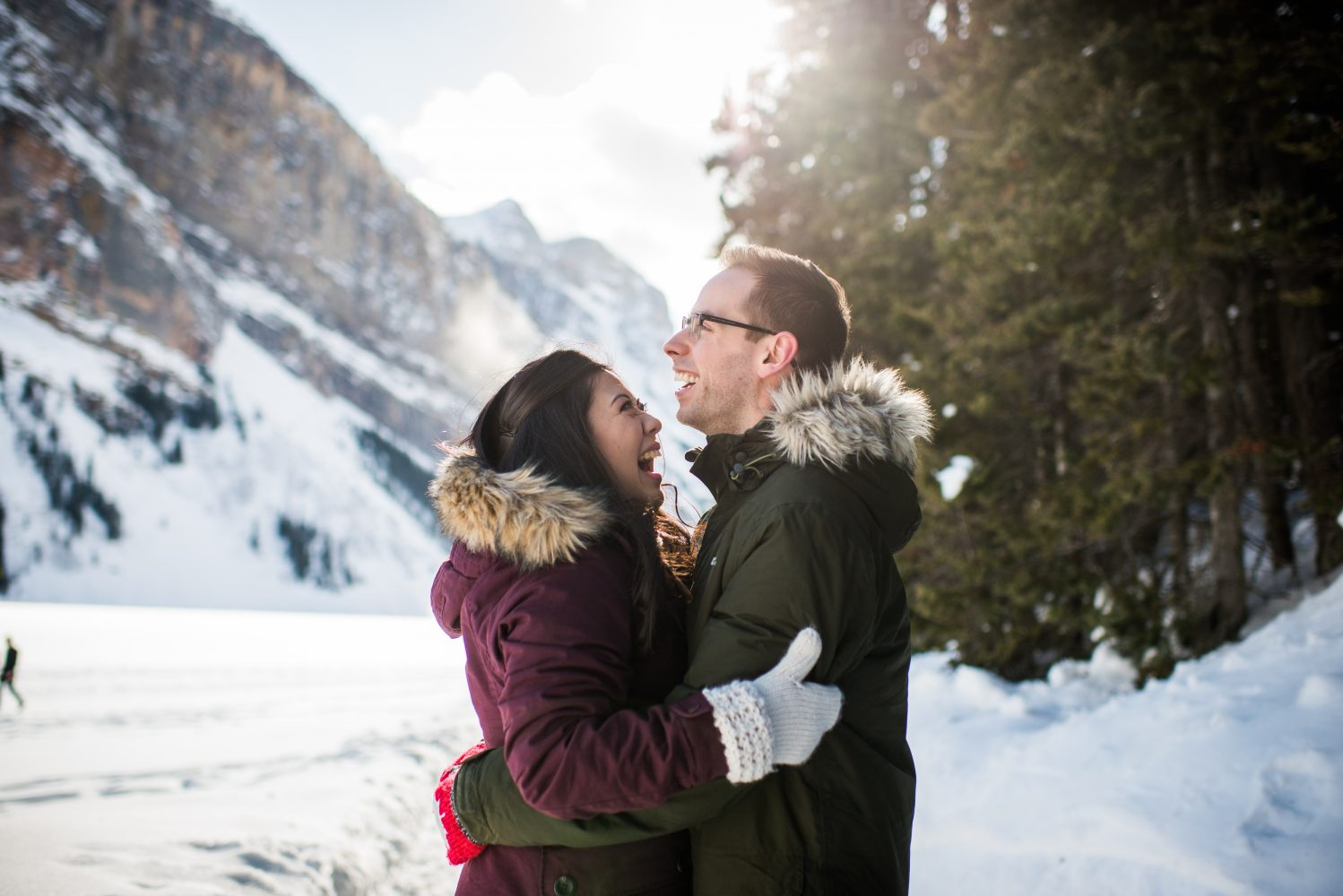 Engagement Photography at the stunning fairmont lake louise, snowy sun soaked images of an adorable couple | 3Haus Photographics