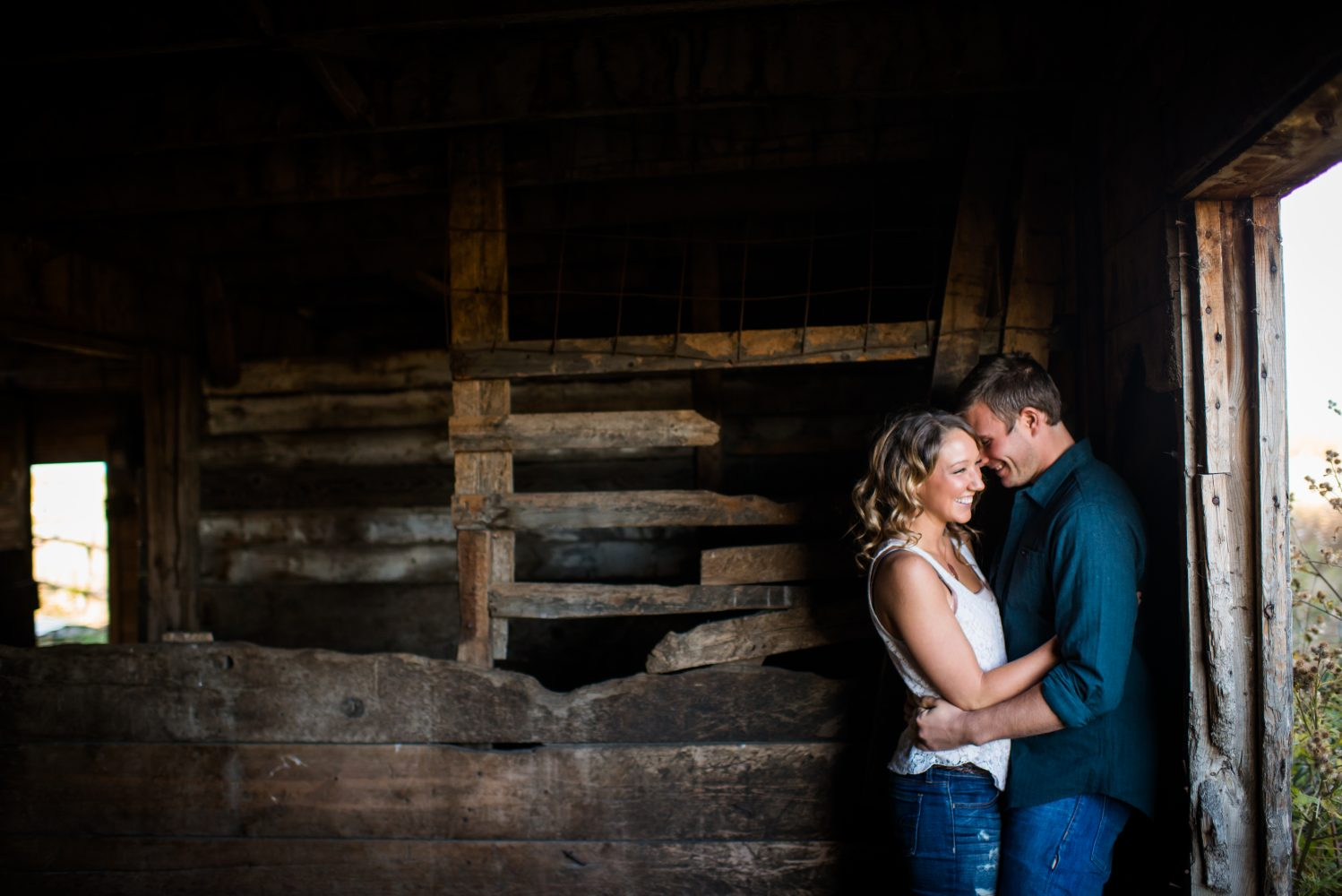 Fun engagement photographs in a rural barn around Edmonton Alberta | 3Haus Photographics