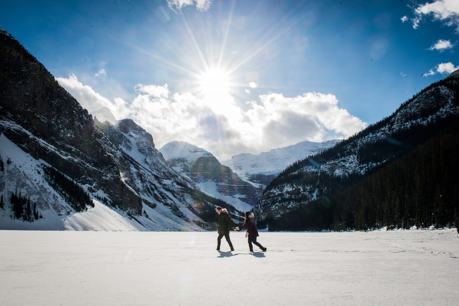 A beautiful mountain engagement session at the fairmont lake louise hotel. Snow covered and and sunny made for epic photos | 3Haus Photographics