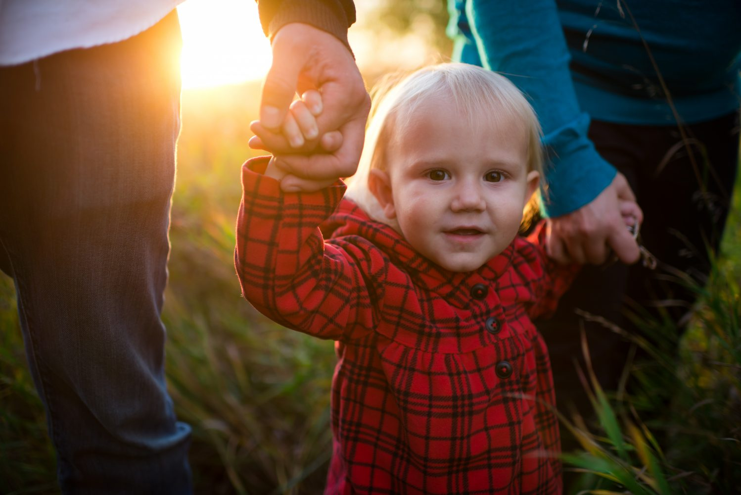 A sweet picture of a little girl and the beautiful golden hour light streaming in | 3haus Photographics
