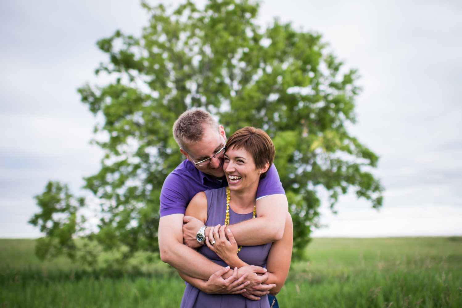 Nose hill park with an epic tree and a couple in love engagement session | 3Haus Photographics