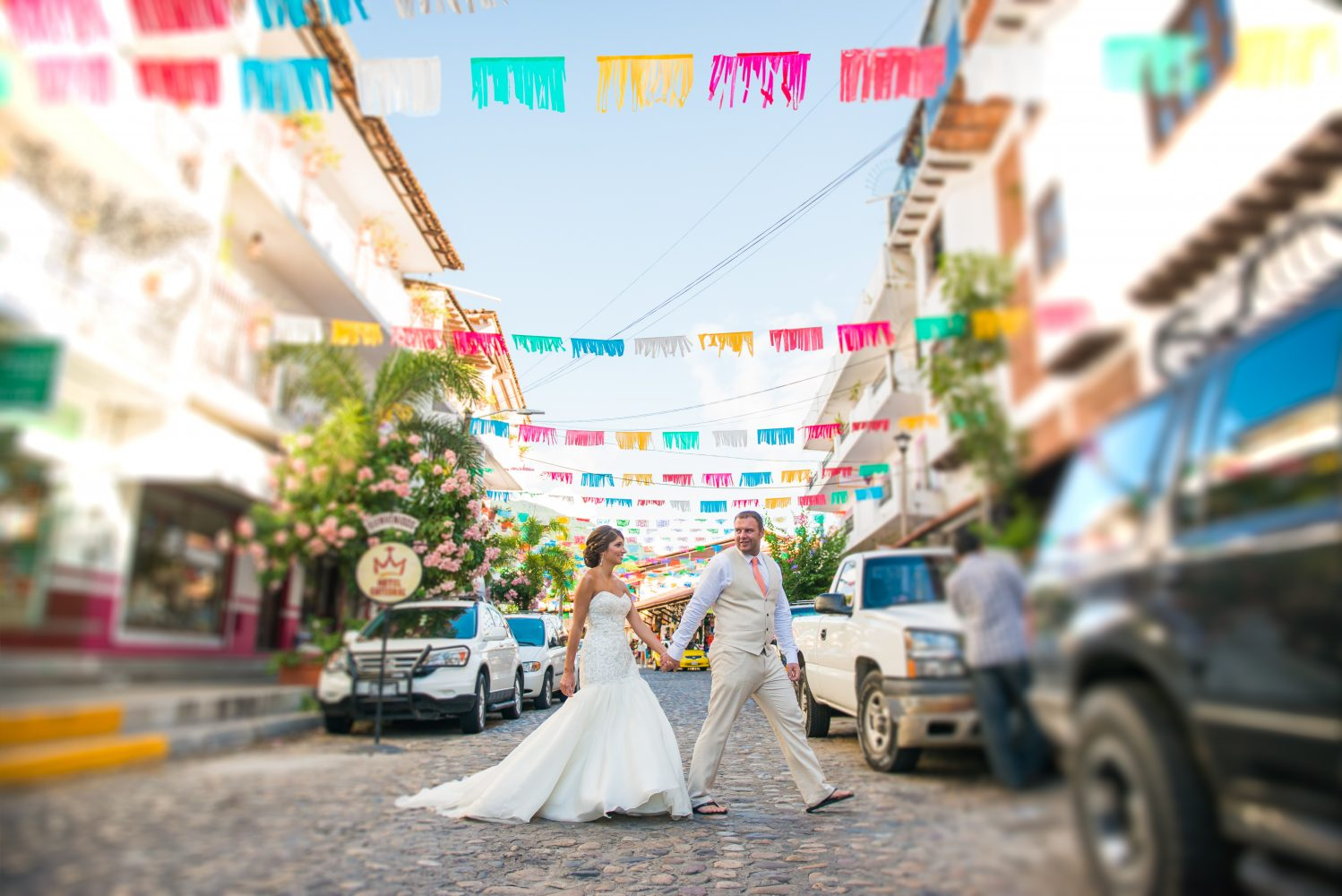 Mexico wedding in Puerto Vallarta, vibrant colors and a beautiful capture of the Bride and Groom outside of Old Puerto Vallarta | 3Haus Photographics