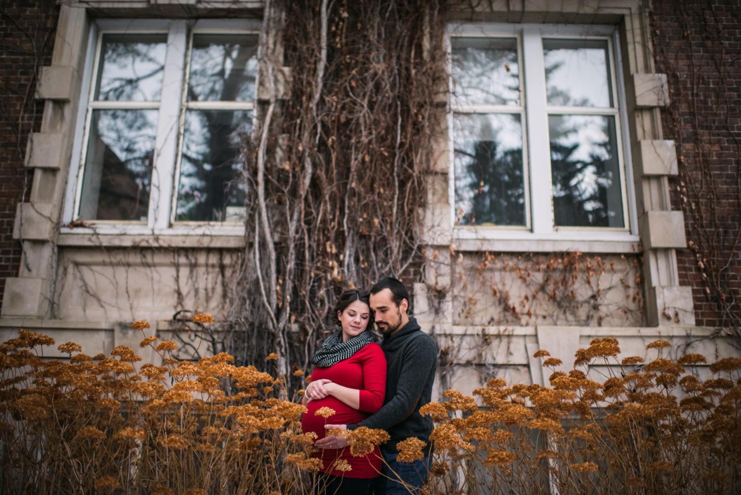 Couples amongst the winter flowers in their intimate maternity session at the University of Alberta | 3haus Photographics