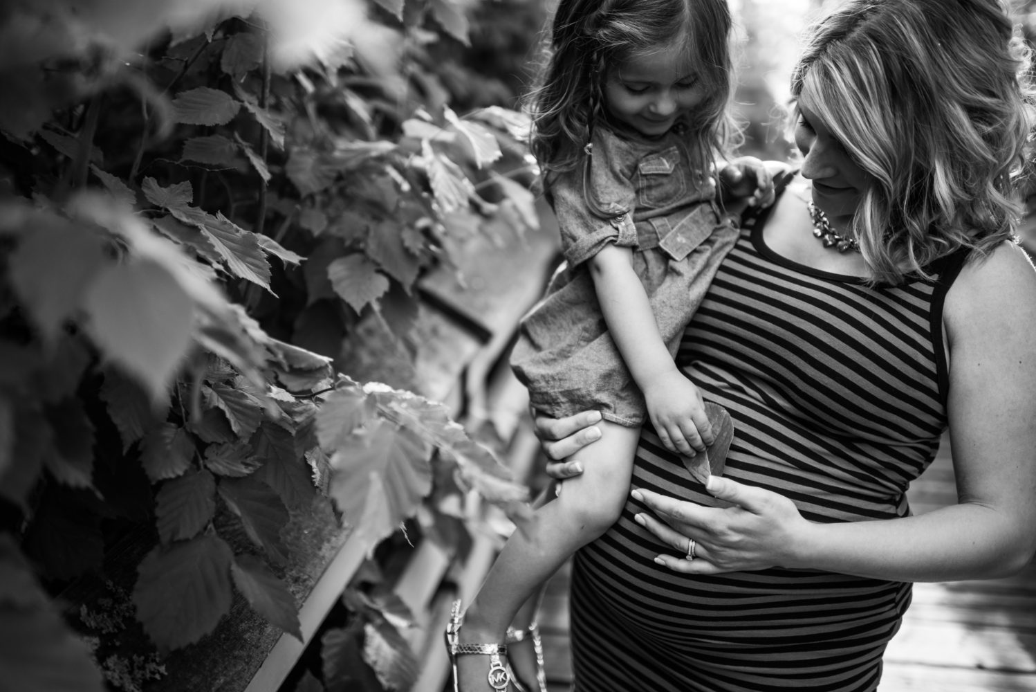 A beautiful moment between mother and daughter as they touch their soon to be baby |3Haus Photographics
