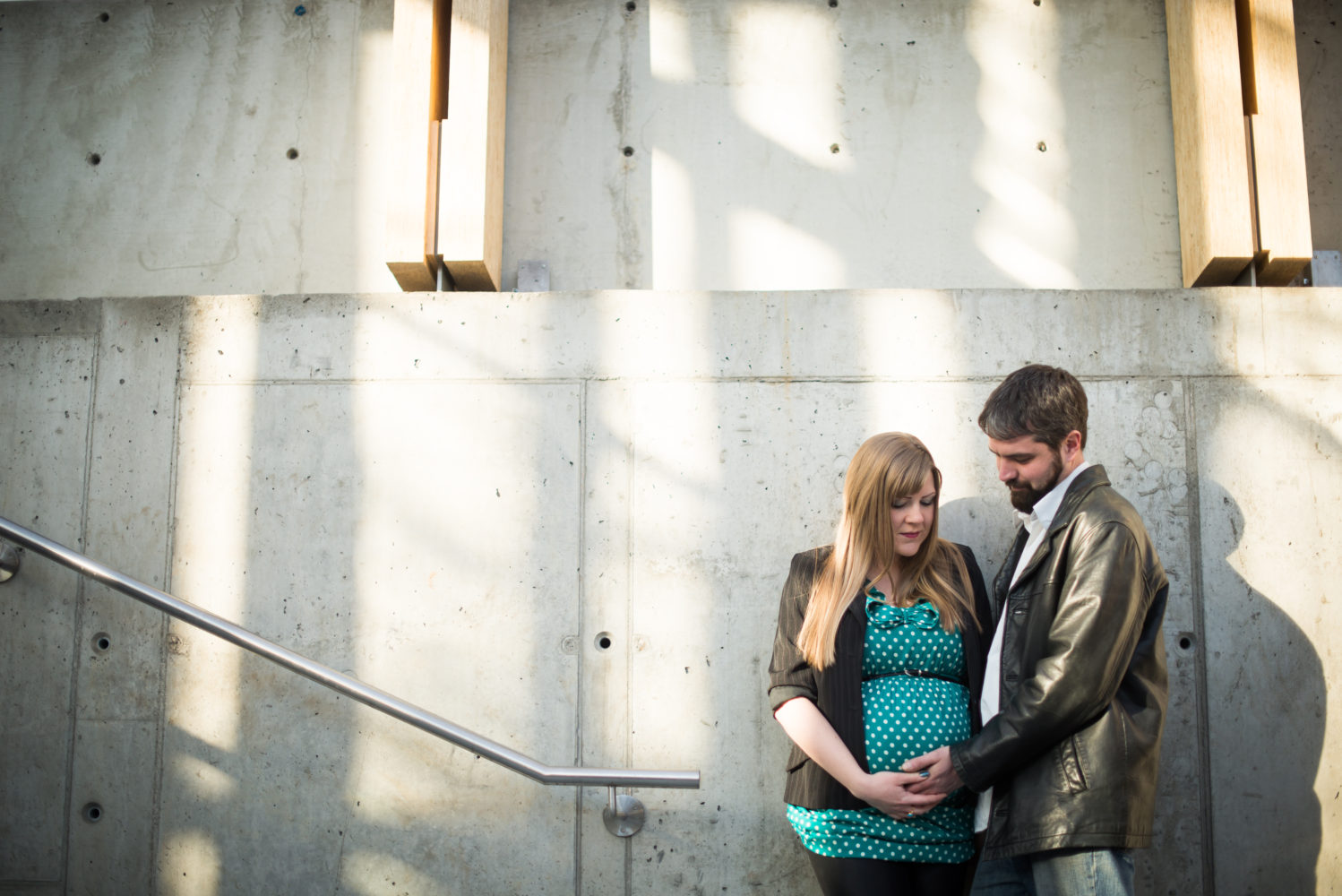 Creative use of light and location with the SAIT parking garage in theis maternity session | 3Haus Photographics