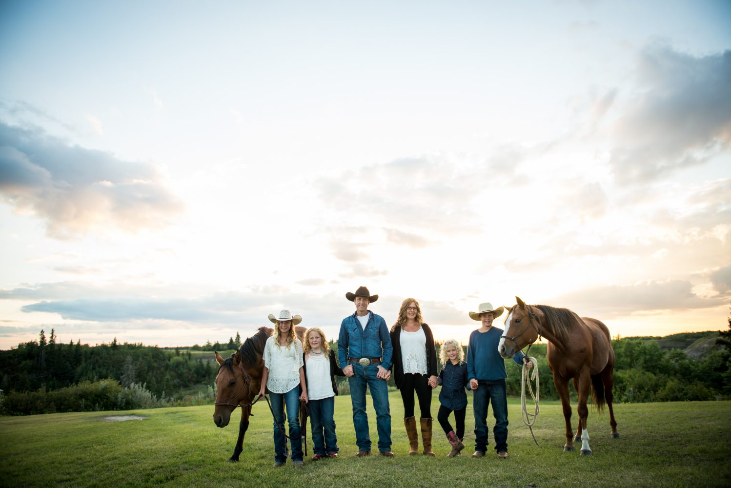 Epic family photograph with horses, during a beautiful sunset at Circle square Ranch | 3Haus Photographics