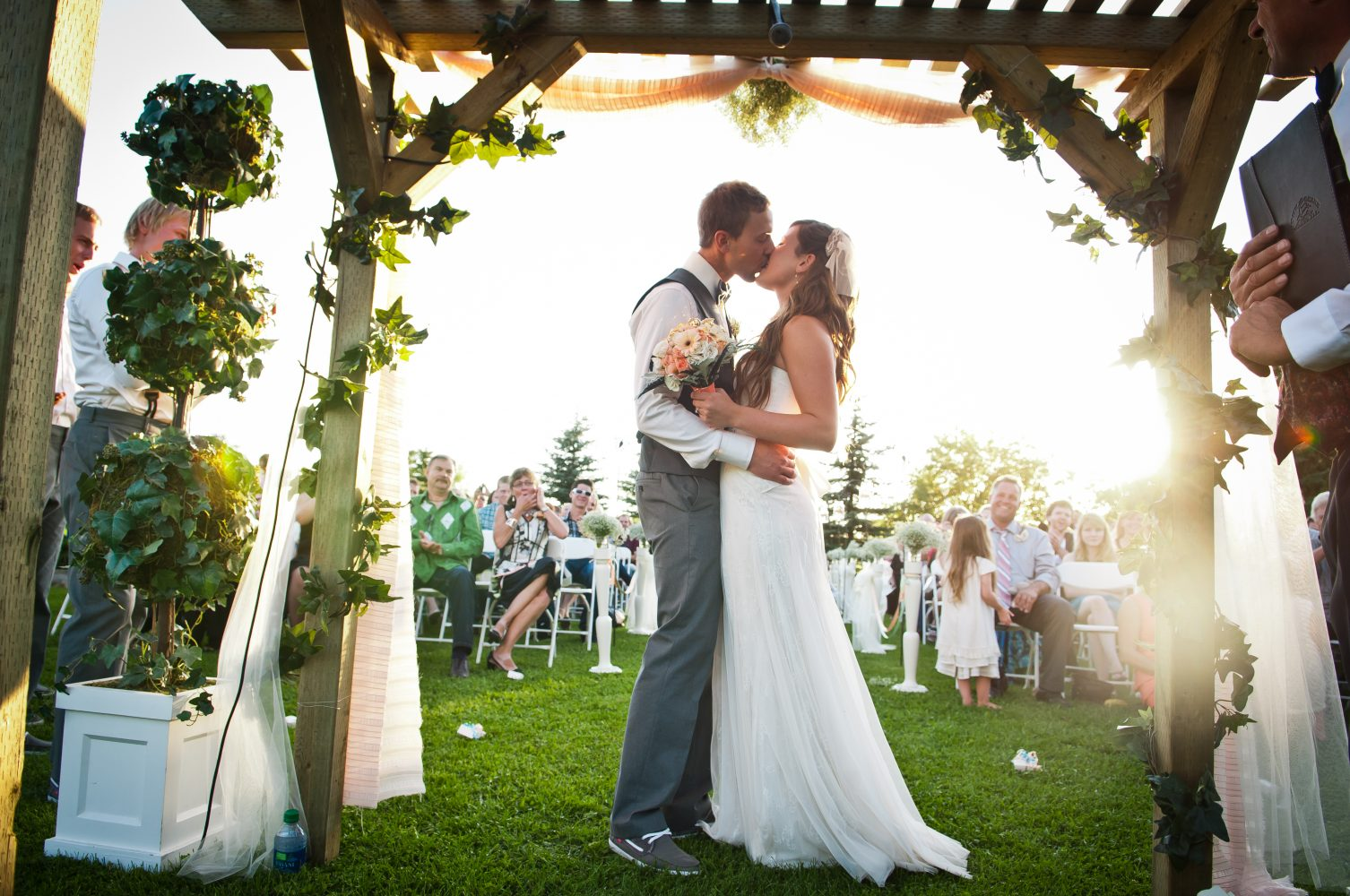 A farm wedding kiss at sunset in Rural Alberta, I now pronounce you Husband and Wife | 3Haus Photographics