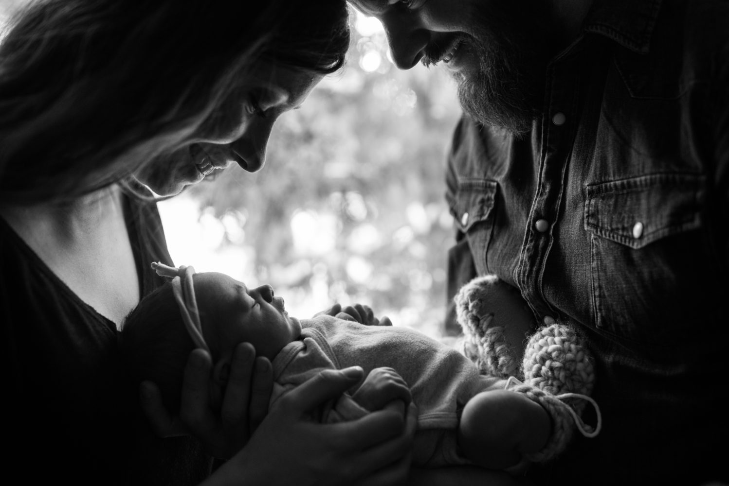 A stunning black and white photograph of parents adoring their newborn baby girl | 3Haus Photographics