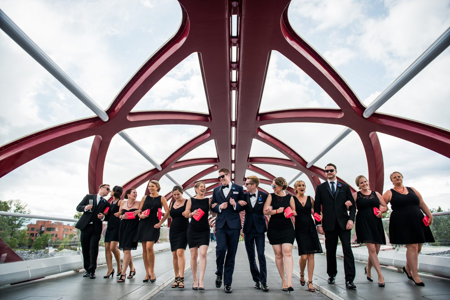 A stylish gay wedding with their bridal party photos taken on the peace bridge in Calgary Alberta | 3Haus Photographics