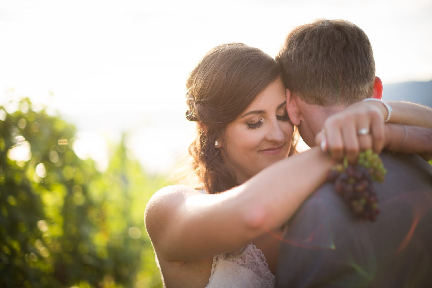 Pyramid Hill Winery in Kelowna and a portrait of the bride and groom in the vinyard | 3Haus Photographics