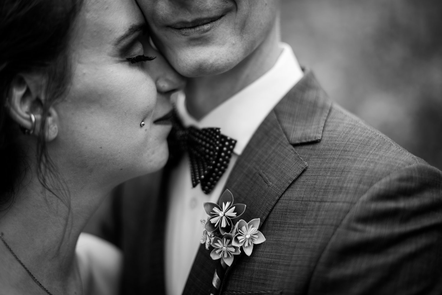 DIY wedding details of the Boutinaire on the groom all handmade for their wedding at Rundles Mission on Pigeon Lake Alberta | 3Haus Photographics