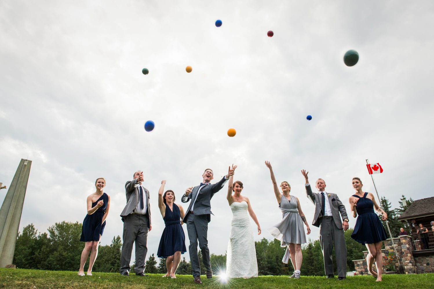 Having fun playing Bocce ball during their reception at Rundles Mission in Pigeon Lake Alberta | 3Haus Photographics
